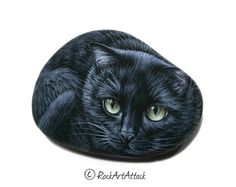 A Smouth Beach Stone is Hand painted with acrylics and small brushes and Transformed into a beautiful black cat! Handmade by the Greek rock painting artist Lefteris Kanetis ( Rock Art Attack).