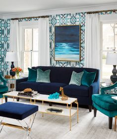 The foyer connects to a formal living space, which the homeowners use for entertaining. Both rooms are rich with blue tones. Bold Living Room, Colourful Living Room, Living Room Decor, Living Room Accessories, Home Accessories, Family Room, Home And Family, Of Wallpaper, Graphic Wallpaper