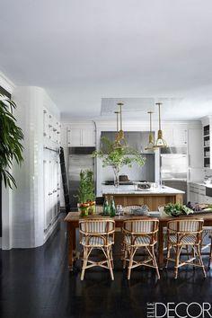 tile detail on ceiling. column fridge/freezer. tile on wall