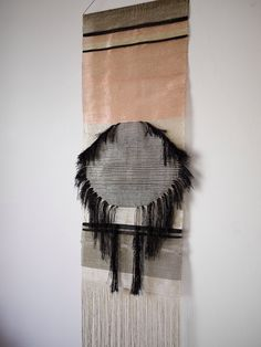 Weaving by justine ashbee for native line. Woven copper and silver wall hanging.