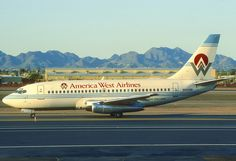 America West Airlines Boeing 737-222 N144AW at Phoenix-Sky Harbor, February 1992. N144AW changed hands eight times over the course of 33 years in commercial service. (Photo via Flickr: Aero Icarus)