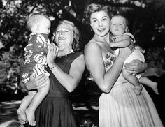 June Allyson and Esther Williams hold their sons, Dick Powell Jr. and Kim Gage, 1951 pool party. Look at those babies!
