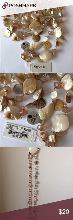 """MACY'S STYLE & CO WHITE SHELLED LONG NECKLACE 40"""" Welcome to My Store!  This is a Brand New  LOT 1 MACY'S STYLE & CO WHITE SHELLED LONG NECKLACE 40""""  CHAIN & CRSYTALS   WOMEN'S LADIES FASHION JEWELRY  This is a long shelled chain necklace w/ crystals.  This has a lot of shells wiht different designs link to each other & form a long necklace.  approx 40"""" inches long.  This comes from a Smoke-Free & Pet-Free Environment.  Let me know if you have any questions.  Thank you & Have a Great Day…"""