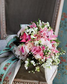 A romantic bouquet with pops of neon pink