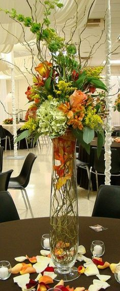 Tall wedding centerpiece www.tablescapesbydesign.com https://www.facebook.com/pages/Tablescapes-By-Design/129811416695