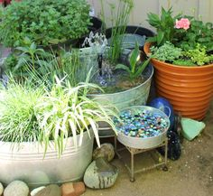 My Water Gardens.  Bird and butterfly bath with marbles and water does NOT cover the marbles to avoid mosquito larvae.
