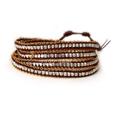 Our Silver Nugget with Gold Chain Wrap Bracelet is fun and stylish! This fabulous bracelet has funky geometric shaped beads with brown leather. The bracelet then has fun gold rolo chain detailing all along the outside. This bracelet is 39 in length and .375 inches in width. The bracelet has a toggle style clasp and weighs 47.8 grams. This piece would look great with other gold jewelry or other wrap bracelets!