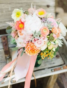 colorful bouquet of peonies, poppies, ranunculus, veronicas and succulents!