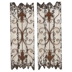 Two-piece wood and metal wall decor set. Product: Set of 2 wall decorConstruction Material: Wood and metal...