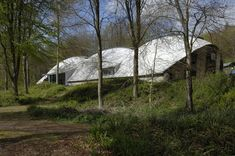 Workshop at Hooke Park designed by Richard Burton of ABK and Frei Otto with Buro Happold. vault uses compression arches