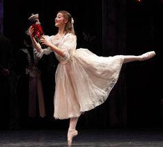 Benedicte Bemet as Clara with the Nutcracker in Act 1 of the Australian Ballet's Nutcracker.