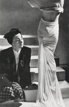 Madame Grès posing next to her model, 1946