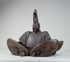Portrait said to be of Minamoto no Yoritomo, Wood, colored, Kamakura period/13-14th century  Tokyo National Museum. This seems to be an image of Minamoto Yoritomo, which was possessed by Tsurugaoka Hachimangu in Kamakura. It wears an eboshi (a type of headgear worn by court nobles) and hunting clothes and sits cross-legged. Tsurugaoka Hachimangu, he talked to the image of Yoritomo while patting it on its shoulder.