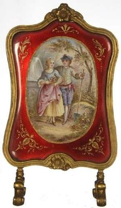 French enamel fireplace screen, 4-inch, showing a mad and woman courting, medallion with red border.