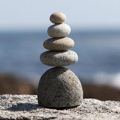 """5 part natural beach pebbles / river rocks stacked with metal rod support in middle. Size: Approx. 4.5"""" x 3.5"""" x 9.5""""H Weight: 5-7 lbs."""