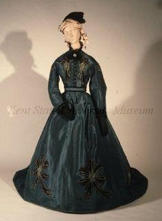 1860's Emerald green silk taffeta dress with black velvet bows appliqued with steel cut beading.