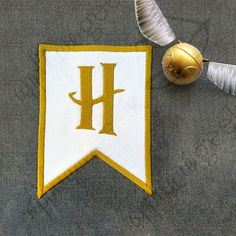 This is a Harry Potter inspired design of a flag with an H for Hogwarts embroidered in the middle.