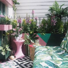 Pink is perfect for outdoors. See how fabulous it is on this balcony where it echoes the planting and gives a harmonious mix with the green. Pastel pink and green is just the perfect combo.