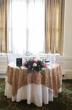 Gold Sequin Sweetheart Table   Photo: Ashley Giffin Photography   Flowers: Blumengarten Florist  