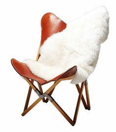 Handmade leather Butterfly chair, $850, and sheepskin rug in White, $160, LivedIn Coogee.