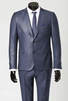 Blue grey suit with matching skinny tie and white shirt