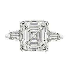 Diamond engagement ring, centering on an emerald-cut diamond weighing 5.26 carats, with tapered baguette cut diamond shoulders, mounted in platinum.