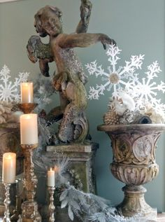 Statuary, snowflakes and candle vignette via Quilted Nest Blog