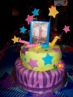 Gymnastics Birthday Cake By trat91 on CakeCentral.com   I like the idea of using a small framed photo for the topper