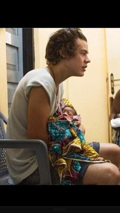 Harry styles holding a baby in Ghana. I can't take this.