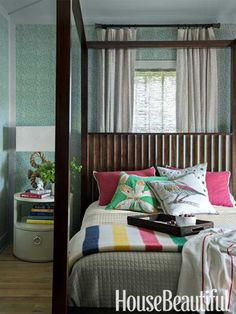 Guest bedroom in a lake house. Design: Thom Filicia. housebeautiful.com. #bedroom #stripes #four_poster_bed #color