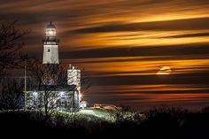 A long exposure of the moon rising besides the Montauk Lighthouse on a cold winter night. I was really excited about how the clouds turned out on this shot, with the late rising moon casting an orange-red glow through the night.  #montauk #moonrise #longisland #ny #longexposure #moon #lighthouse #clouds #redmoon #nightsky #montauklighthouse