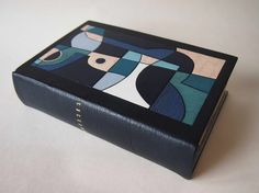 Ulysses bound by Derek Hood // covered in full dark blue goatskin with onlays and inlays in various leathers. Joyce's handwritten manuscript of Ulysses printed on natural calfskin and used as onlays.