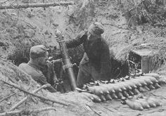 Finnish soldiers firing their 81mm mortar. Continuation war