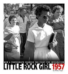 Little Rock Girl 1957: How a Photograph Changed the Fight for Integration by Shelley Tougas. Nine African American students made history when they defied a governor and integrated an Arkansas high school in 1957. It was the photo of one of the nine trying to enter the school a young girl being taunted, harassed and threatened by an angry mob that grabbed the world's attention and kept its disapproving gaze on Little Rock, Arkansas.
