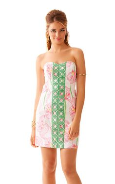 The Angela classic strapless dress has a sweetheart neckline and top applied lace down the center front. The lace combined with the classic floral pink and white print makes this a classic spring Lilly dress.