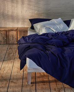 Give your bed an upgrade with our ice blue and navy bedding set. Washed cotton is luxuriously soft to the touch and highly breathable, helping to regulate body temperature through the night. It is an effortless fabric, designed to look good even without ironing. Crafted from the finest fibres in Portugal. Beige Bedding Sets, Dark Grey Bedding, Striped Bedding, Green Bedding, White Bedding, Bedroom Inspiration, Grey Stripes, Luxury Bedding, Duvet