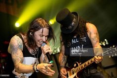 Slash (R) and Myles Kennedy perform at Slash featuring Myles Kennedy and the Conspirators at The Hollywood Palladium on October 23, 2015 in Los Angeles, California.