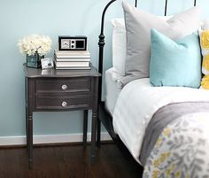 I wouldn't do blue on the walls, but I love the splash of blue on the bed.