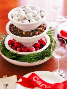 Stack three or four mixing bowls to create tiers for displaying mini ornaments, dried pods or nuts, clipped greens, hard candies, ribbons, tinsel or fruits. Place an upside-down cereal bowl between the layers so mixing bowls don't sit inside each other.