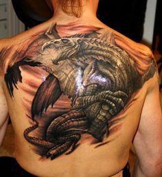 Tattoo A dragon is a symbol of evil or good, bad or good? What does dragon tattoo mean?The dragon is an image of power Dragon Tattoo Meaning, Dragon Tattoo Back, Dragon Tattoos, Mother Daughter Tattoos, Tattoos For Daughters, Dragon Tattoo Designs For Back, France Tattoo, Hyper Realistic Tattoo, Bikini Tattoo