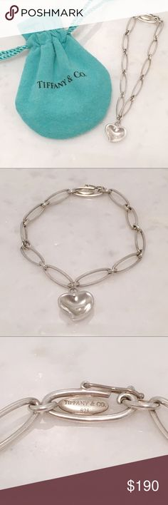Tiffany & Co. Elsa Peretti Heart Silver Bracelet Iconic and beautiful!  This simple design by Tiffany & Co. became an instant classic across the globe.  Made from 925 sterling silver, if features a heart pendant and an interlocking gold chain.  The Tiffany pouch is included. Tiffany & Co. Jewelry Bracelets