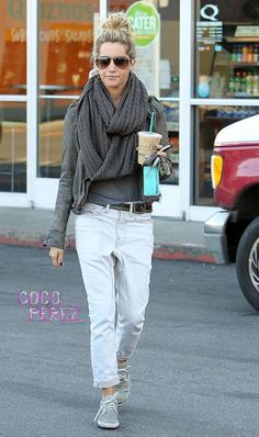 This casual chic look from Ashley Tisdale is pretty fabulous.  Casual white baggy jeans, a gray top, gray casual hoodie, and oversized gray scarf --- love love love