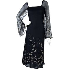 Preowned 1970's Pauline Trigere Black Silk-chiffon Glitter Illusion... ($750) ❤ liked on Polyvore featuring dresses, black, aesthetic evening dresses, bell sleeve dress, transparent dress, feather dress, vintage swing skirt and vintage cocktail dresses