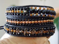 SLINKY BLACK & Amber Triple Wrap Black Leather Bracelet with Czech Fire-Polished,Toho Glass Beads, Swarvoski Crystals and Dark Bronze Button