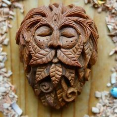 carved avocado pit green man