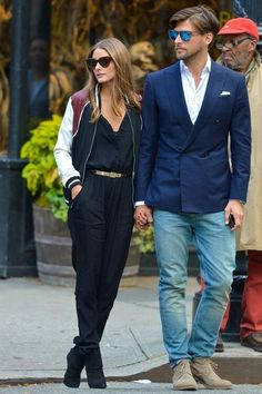 Olivia Palermo in bomber jacket with black jumpsuit