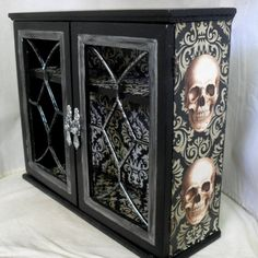 Gothic home decor cabinet with skulls by NacreousAlchemy