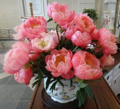 Coral Charm Peonies Grace Desk in Galleries Reception Area ...
