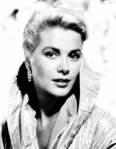 Grace Kelly  Butterfly lighting; body faces one direction, face turns another.  Background is slightly blown out.