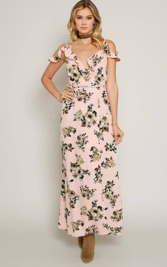 Sleeveless woven midi wrap dress featuring a surplice v-neckline with ruffle trim. Two-toned floral print throughout. Cold shoulder accents and scooped high low hemline. Self tie front and tie back details. Unlined. Woven. Lightweight.100% PolyesterMachine Wash ColdImportedModeled in Size Small